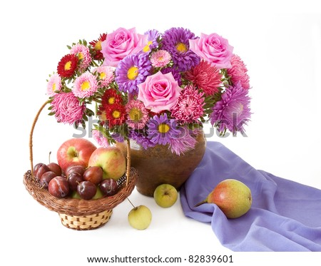 Still life with huge bunch of roses and asters and fruits (apples,plums and pear) isolated on white