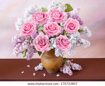 Still life with huge bunch of roses, lilac flowers  on painting background