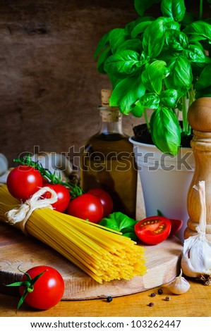 Still life with italian cooking ingredients for spaghetti