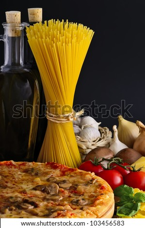still life with italian pizza, pasta and ingredients