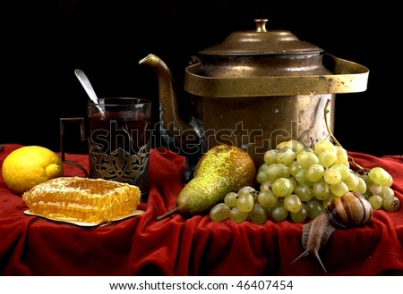 Still life with kettle, tea, grapes, lemon, honey and snail.