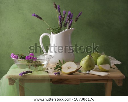 Still life with lavender flowers and pears