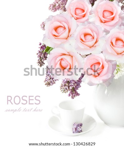 Still life with lilac flowers and roses bunch in vase and cup isolated on white background