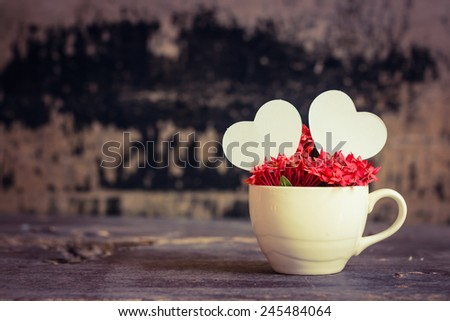 Still life with love.hearts and flower cup
