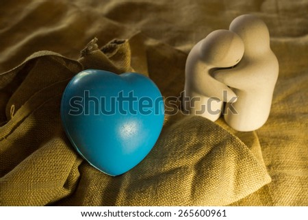 still life with love twin doll and blue heart