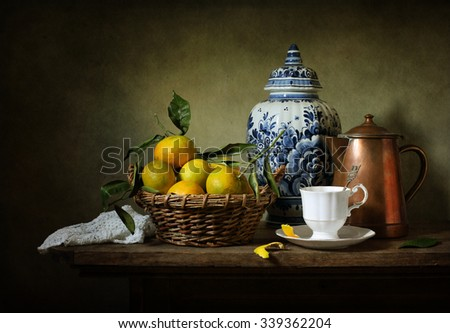 Still life with mandarins and a Delft vase (textured for artistic effect) #339362204