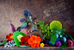Still life with Natural Colors Autumn Leaves, Flowers, Berries on a wooden background