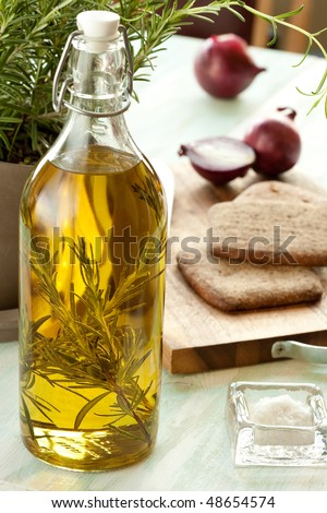 Still life with olive oil, onion, salt, bread, rosemary