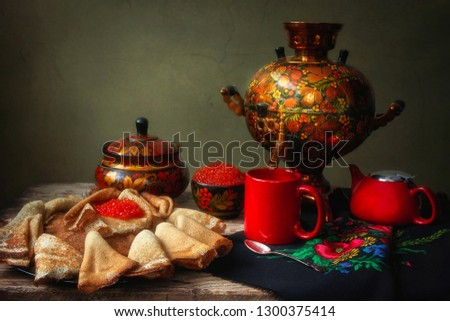 Still life with pancakes and red caviar