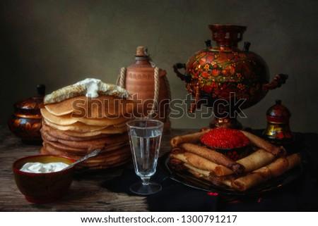 Still life with pancakes and samovar