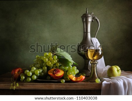 Still life with peaches and green grapes
