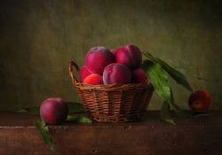 Still life with peaches in the basket