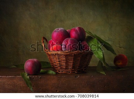Still life with peaches in the basket #708039814