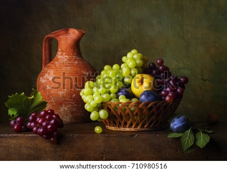 Still life with pears and grapes and plums #710980516