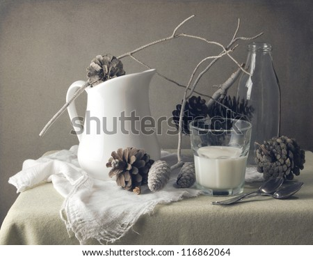 Still life with pine corn and glass of milk
