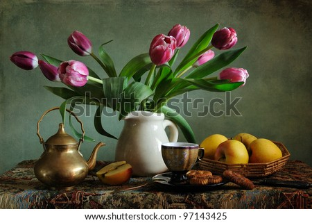 Still life with pink tulips and apples