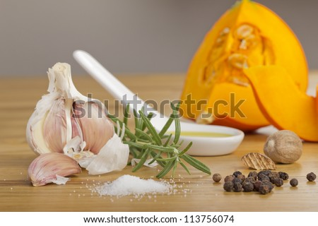 Still life with pumpkin and spices on a wooden plate - stock photo