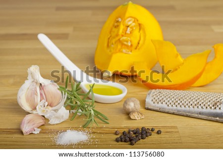 Still life with pumpkin and spices on a wooden plate