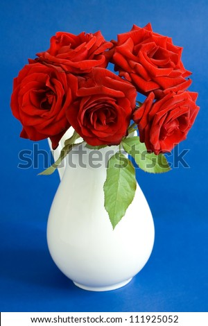 Still life with red velvet rose bouquet on painting background