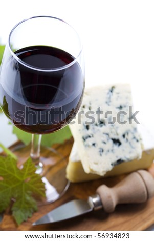 Still life with red wine and cheese