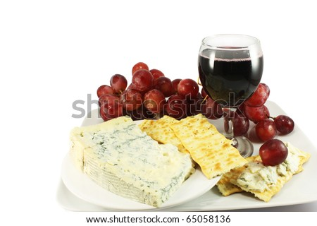 Still life with red wine, blue cheese, crackers and grapes