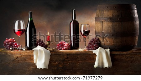 still life with red wine on old wood