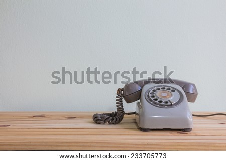 Still life with retro phone on wooden table over grunge background #233705773