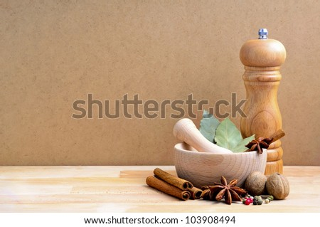 still life with spices and copy space on a wooden background - stock photo