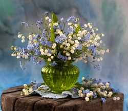 still life with spring lilies of the valley