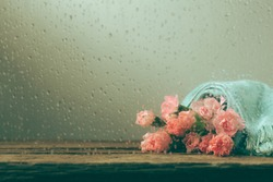 Still life with sweet carnation flowers on wooden table, Mothers day concept