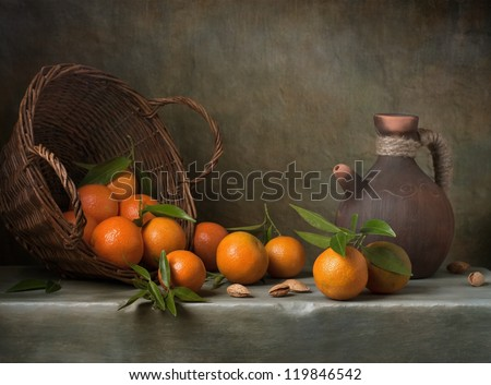 Still life with tangerines and basket