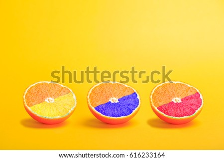 still life with three oranges in several colors - Shutterstock ID 616233164