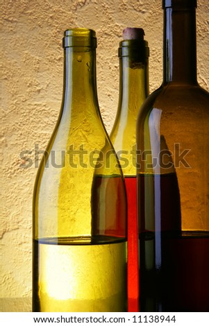 Still-life with three wine bottles close up - stock photo
