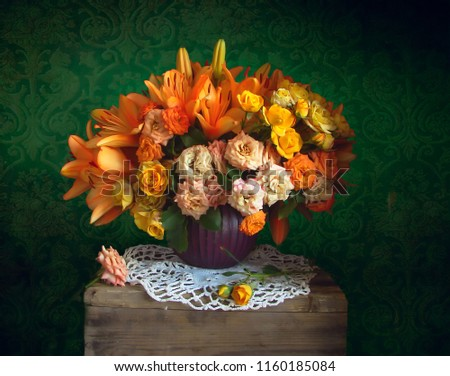 Still life with tiger lilies and a border of roses