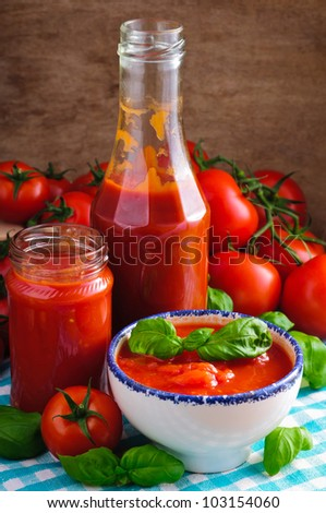 Still life with tomato sauce and ingredients