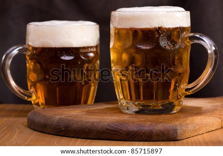 still life with two mugs of beer