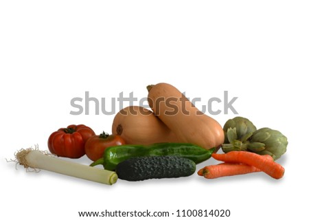 Still life with vegetables consisting of two pumpkins, two carrots, two artichokes, two tomatoes, a leek, a cucumber and a green pepper, over white background. #1100814020