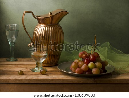 Still life with vintage pitcher and grapes