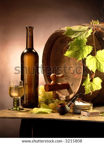 Still-life with white wine, a cask, grapes and a pipe - stock photo