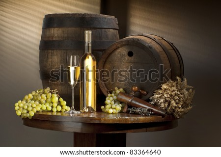 still life with white wine and barrel
