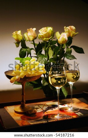 Still-life with white wine, grapes and flowers. Congratulatory card
