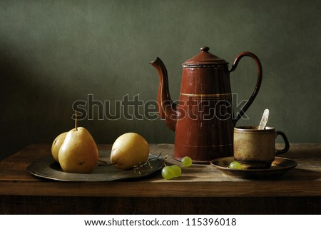 Still life with yellow pears and an old coffee pot