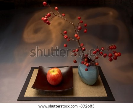 Still life with yellow-red apple and vases