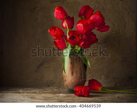 Still life with yellow tulips #404669539