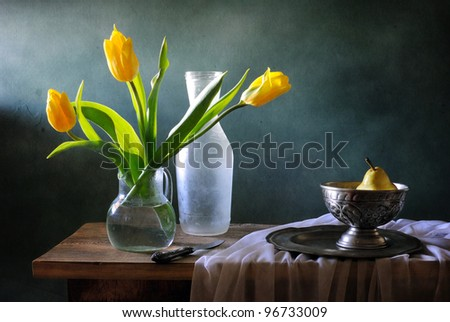 Still life with yellow tulips and pears