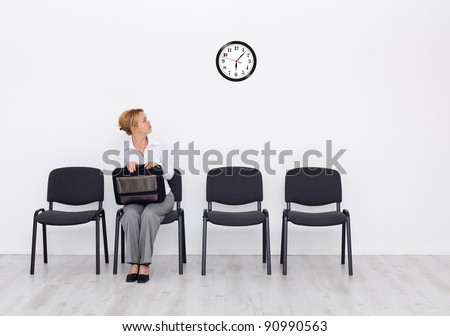 Still waiting for the job interview - woman checking time