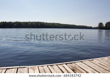 Still Waters by the Dock in Muskoka #684183742