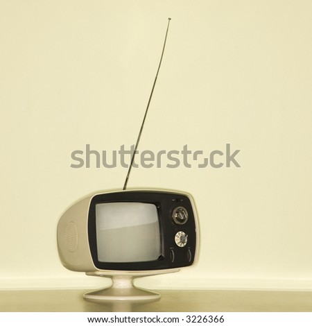 Stilll life of vintage television set with antenna raised.