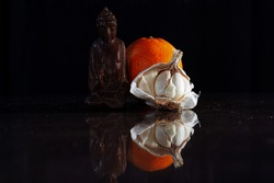 Stilllife Buddha with Orange and Garlic mirroring