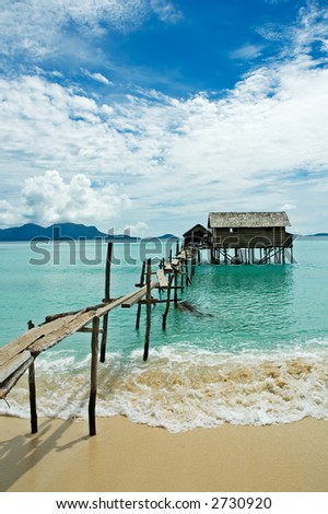 stilt house in tropical waters